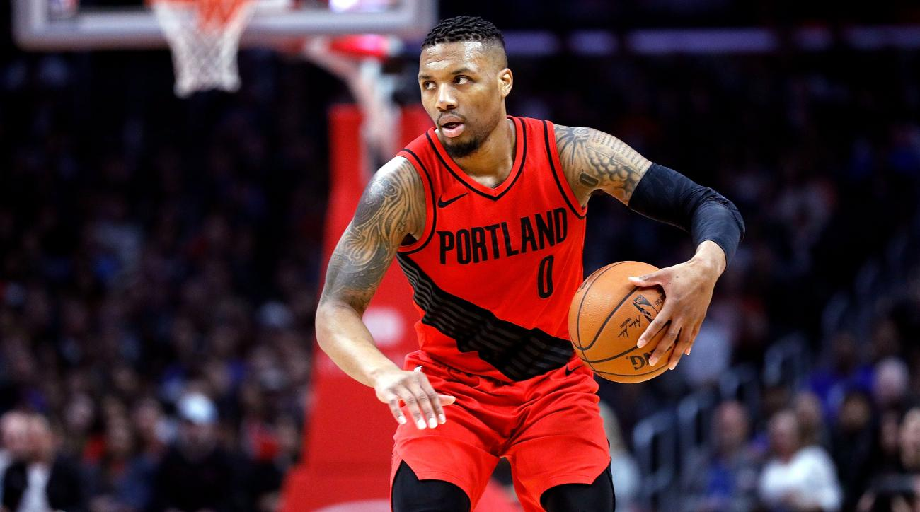 LOS ANGELES, CA - MARCH 18:  Damian Lillard #0 of the Portland Trail Blazers controls the ball during the game against the LA Clippers at the Staples Center on March 18, 2018 in Los Angeles, California.  NOTE TO USER: User expressly acknowledges and agrees that, by downloading and or using this photograph, User is consenting to the terms and conditions of the Getty Images License Agreement.  (Photo by Josh Lefkowitz/Getty Images)