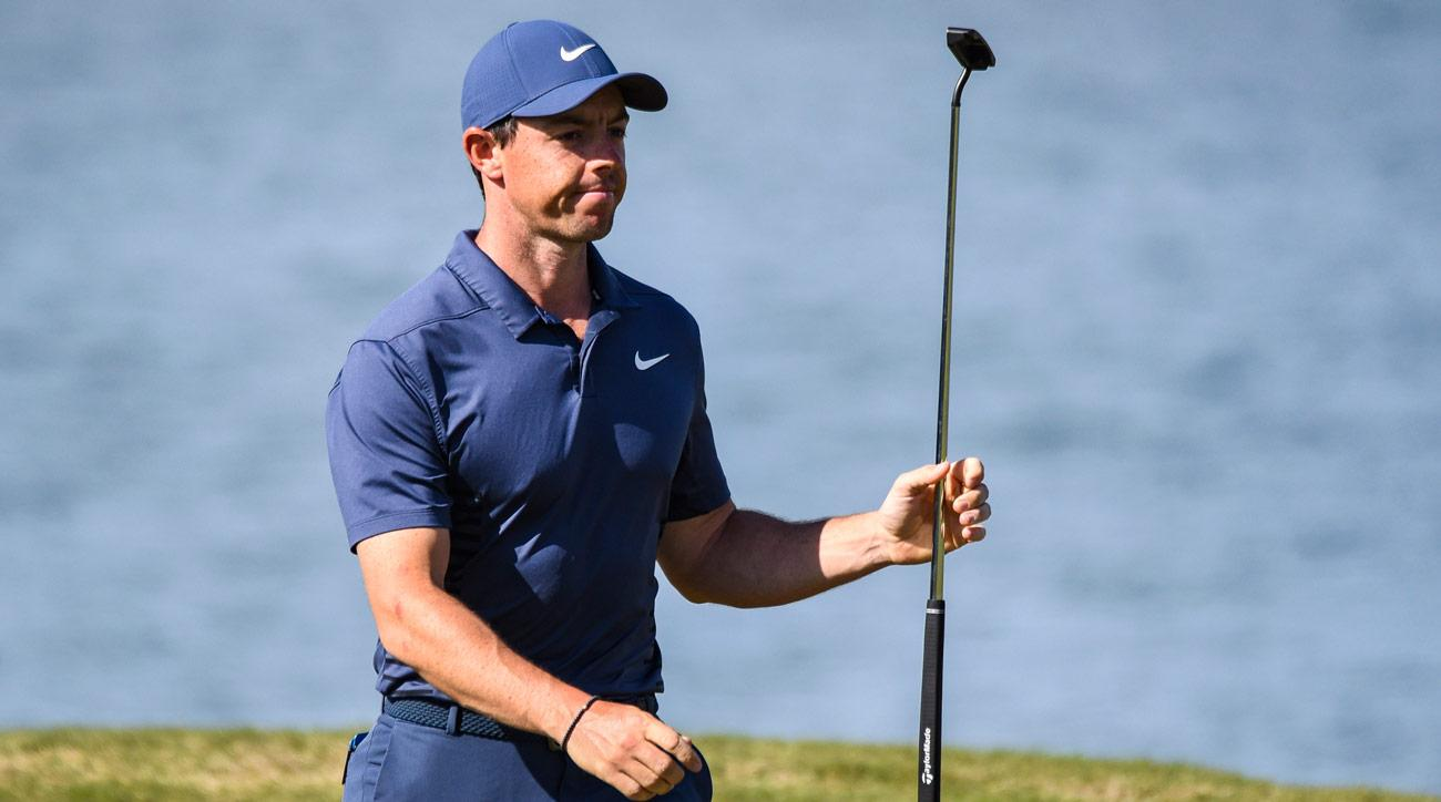 Rory McIlroy celebrates and raises his putter after making a long birdie putt on the 14th hole green during round one of the WGC-Dell Technologies Match Play.