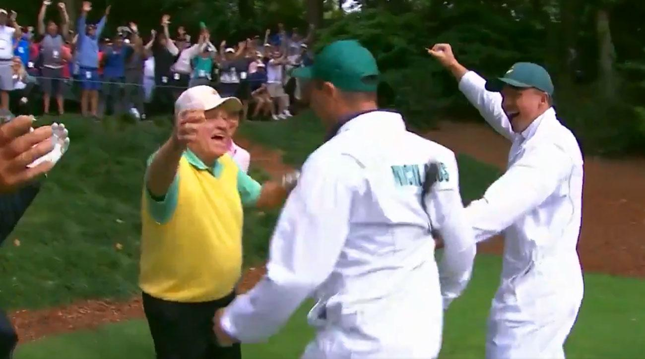 Jack Nicklaus embraces his grandson Gary after Gary made a hole-in-one at the Masters Par 3 Contest.