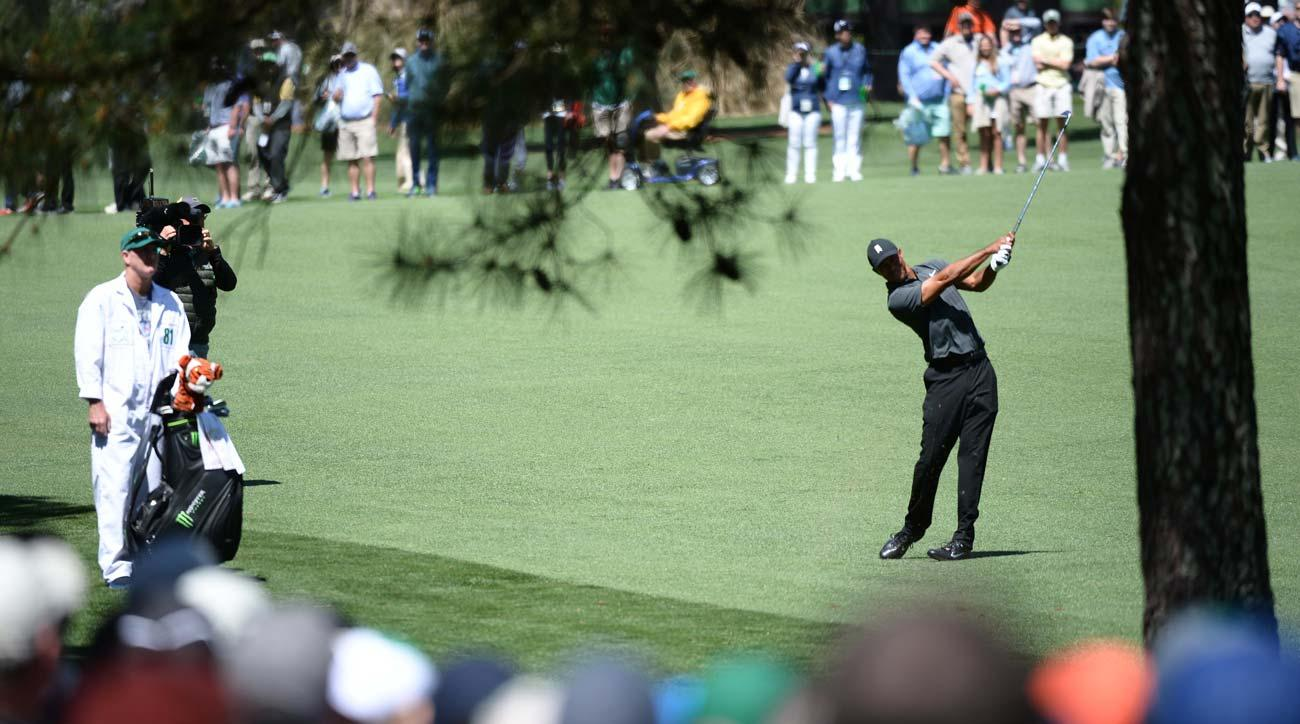 Tiger Woods plays a shot during the first round of the 2018 Masters.