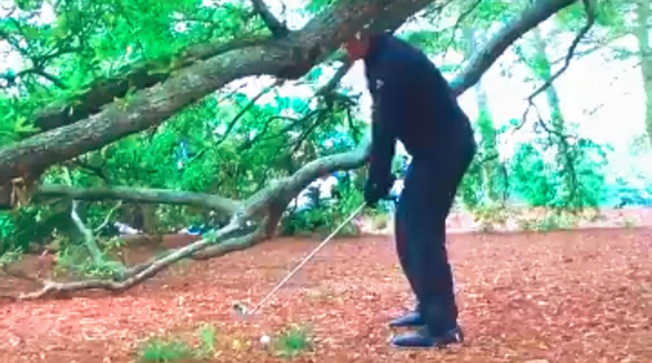 Phil Mickelson prepares to attempt a shot from the trees Saturday on the 1st hole at Augusta National.