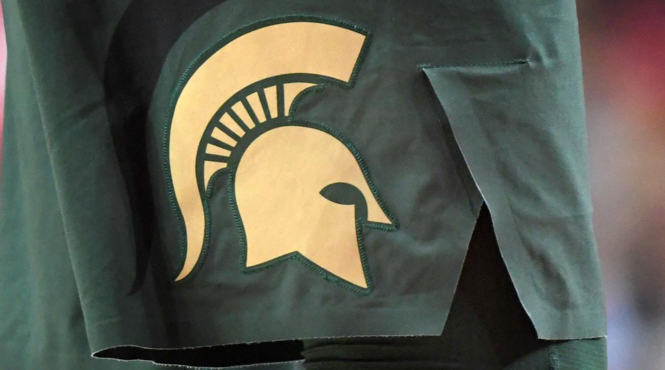 Woman sues MSU, claiming rape by 3 basketball players
