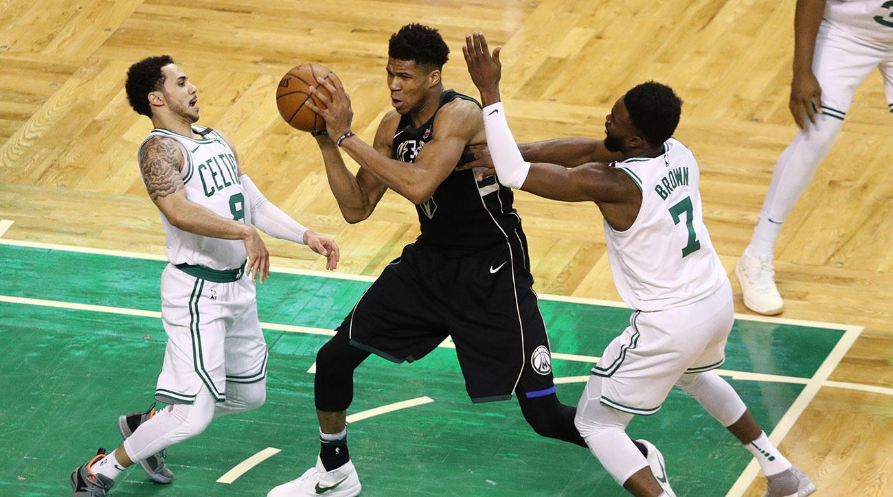 Shane Larkin #8 of the Boston Celtics and Jaylen Brown #7 defend Giannis Antetokounmpo #34 of the Milwaukee Bucks in the fourth quarter of Game Two in Round One of the 2018 NBA Playoffs at TD Garden on April 17, 2018 in Boston, Massachusetts. The Celtics defeat the Bucks 120-106. (Photo by Maddie Meyer/Getty Images)