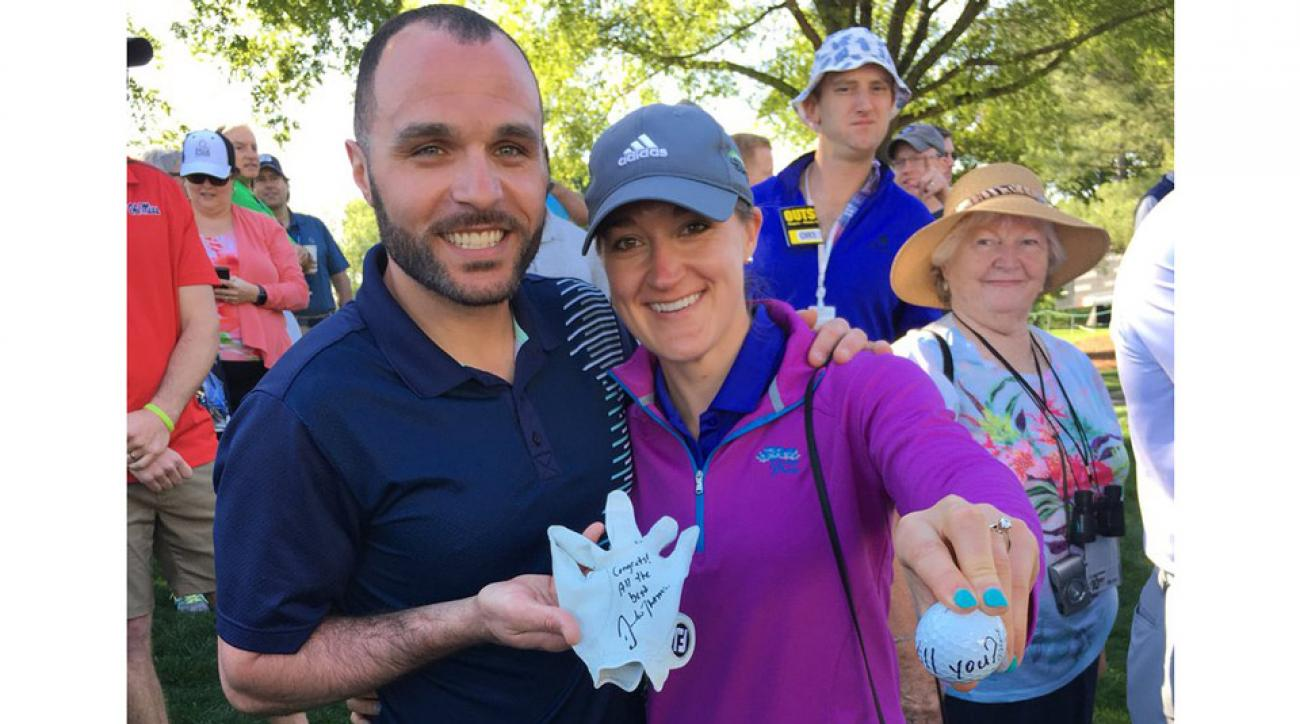 The happy couple poses with their gifts from Justin Thomas.