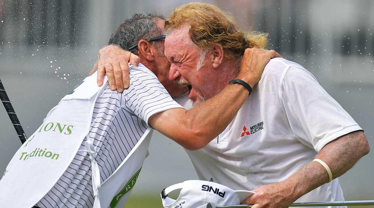 Miguel Angel Jimenez and his caddie Cliffie Botha get doused with champagne after winning the Regions Tradition at Greystone Golf & Country Club on Sunday.