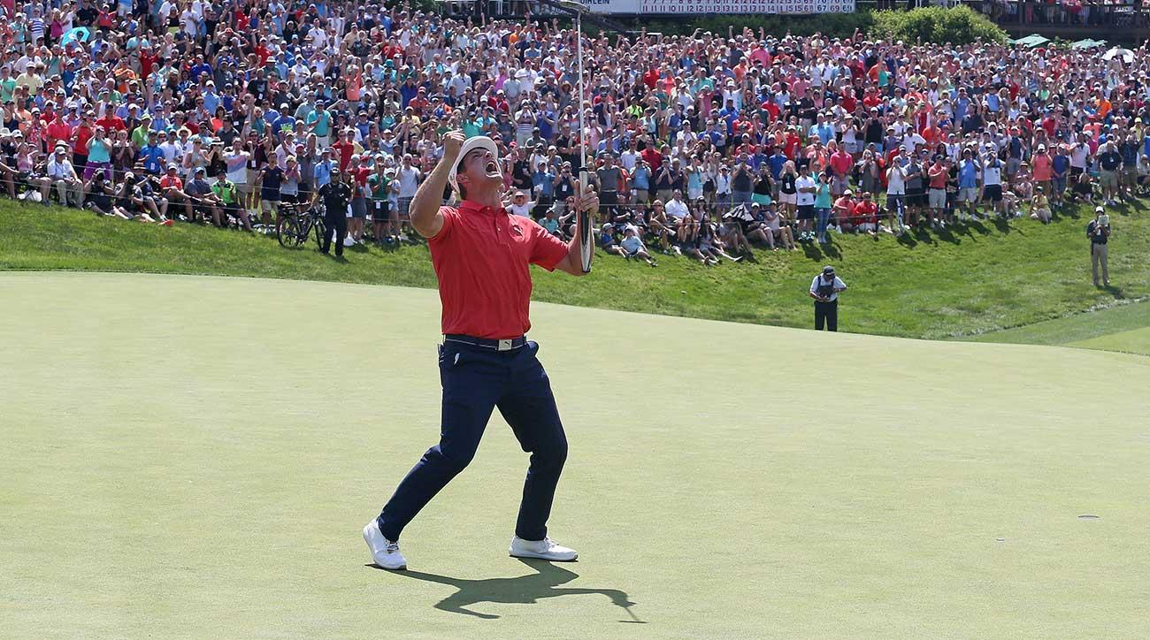 Bryson DeChambeau celebrates after sinking his birdie putt to win the Memorial on Sunday.