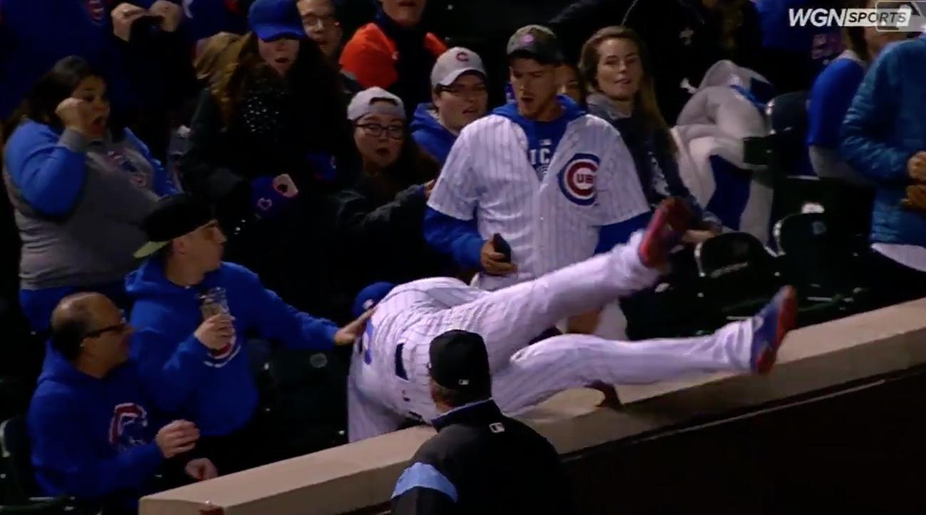 Javy Baez jumps into stands, javy baez catch, cubs, chicago cubs, philadelphia, philadelphia phillies