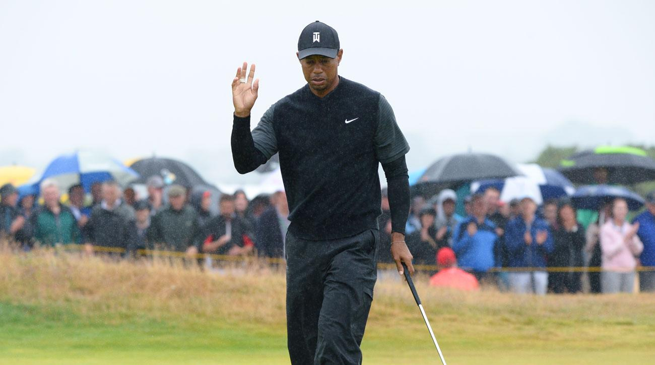 Tiger Woods moves into share of lead at British Open