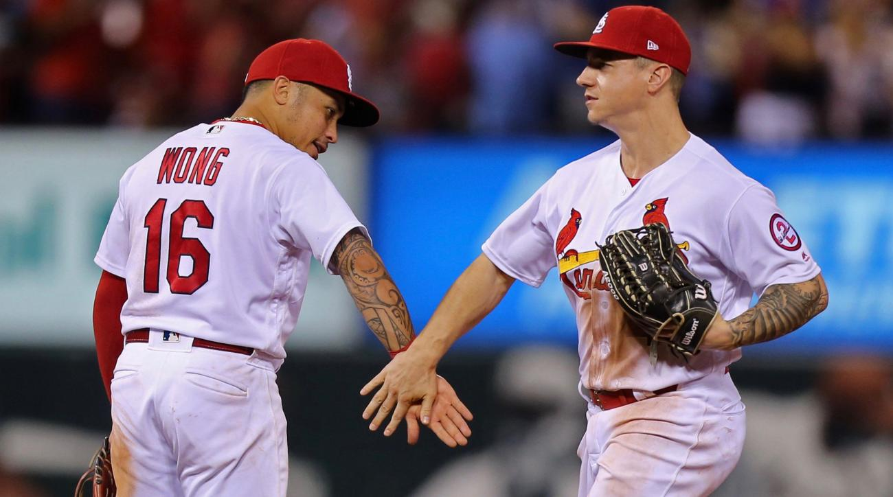 Cardinals beat Brewers, move half-game back of wild-card spot