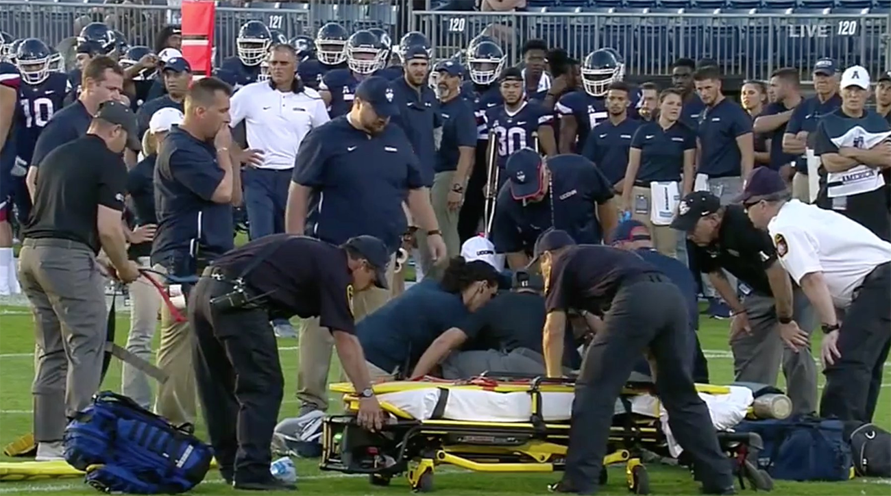 College Football Player Stretchered Off The Field After Opening Kickoff