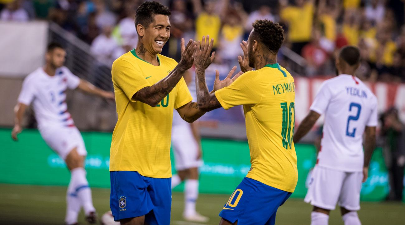 Neymar and Roberto Firmino celebrate during Brazil's 2-0 win over the USA