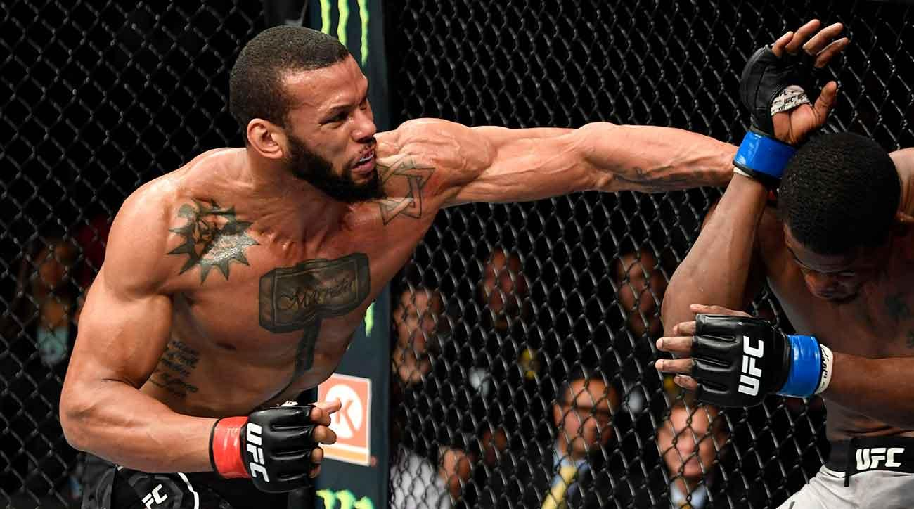 Thiago Santos of Brazil punches Kevin Holland in their middleweight fight during the UFC 227 event inside Staples Center on August 4, 2018 in Los Angeles, California. (Photo by Jeff Bottari/Zuffa LLC/Zuffa LLC via Getty Images)