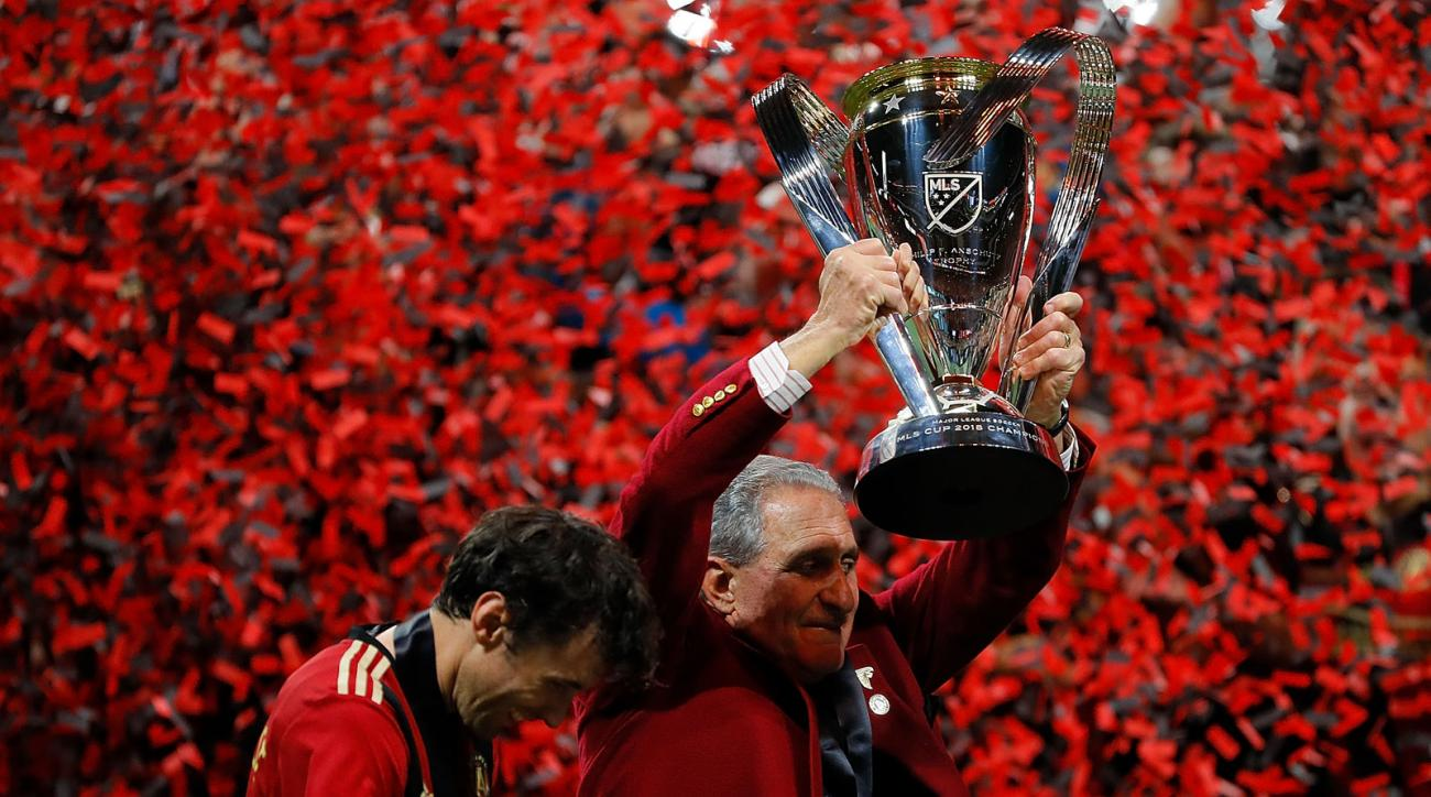 Arthur Blank lifts the trophy for MLS Cup champion Atlanta United