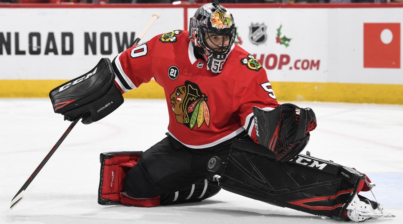 Blackhawks goalie Crawford suffers head injury
