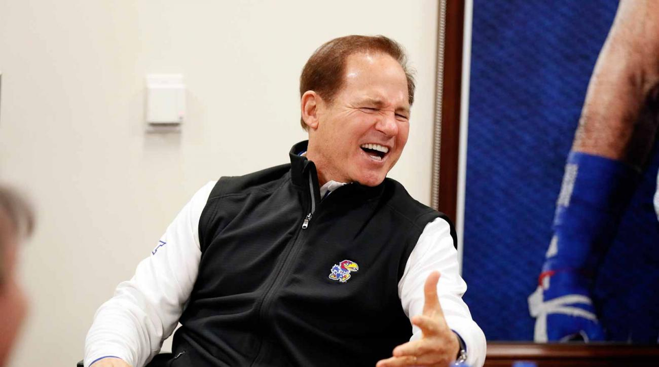 After two seasons away from the sidelines, Miles was brought in by his longtime friend, new Kansas AD Jeff Long, to turn the Jayhawks around.