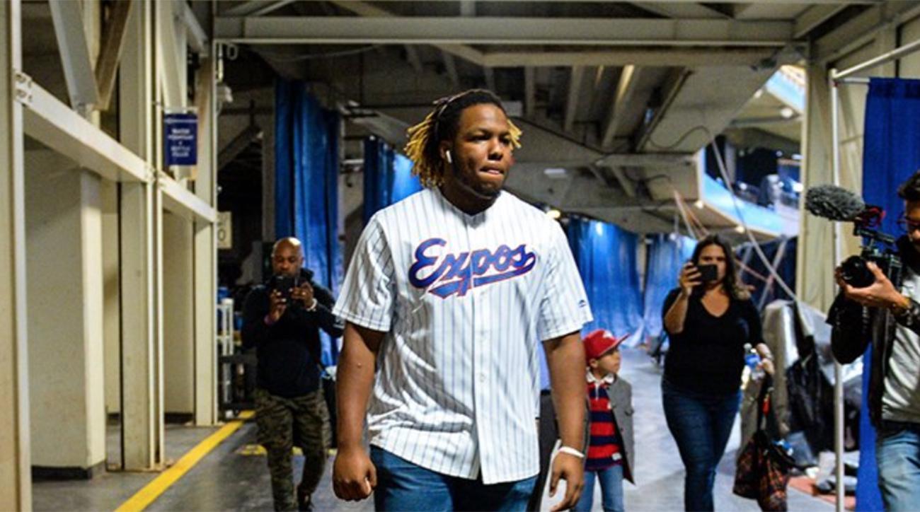 Watch: Vladimir Guerrero Jr. Arrives for His MLB Debut Wearing His Dad's Expos Jersey