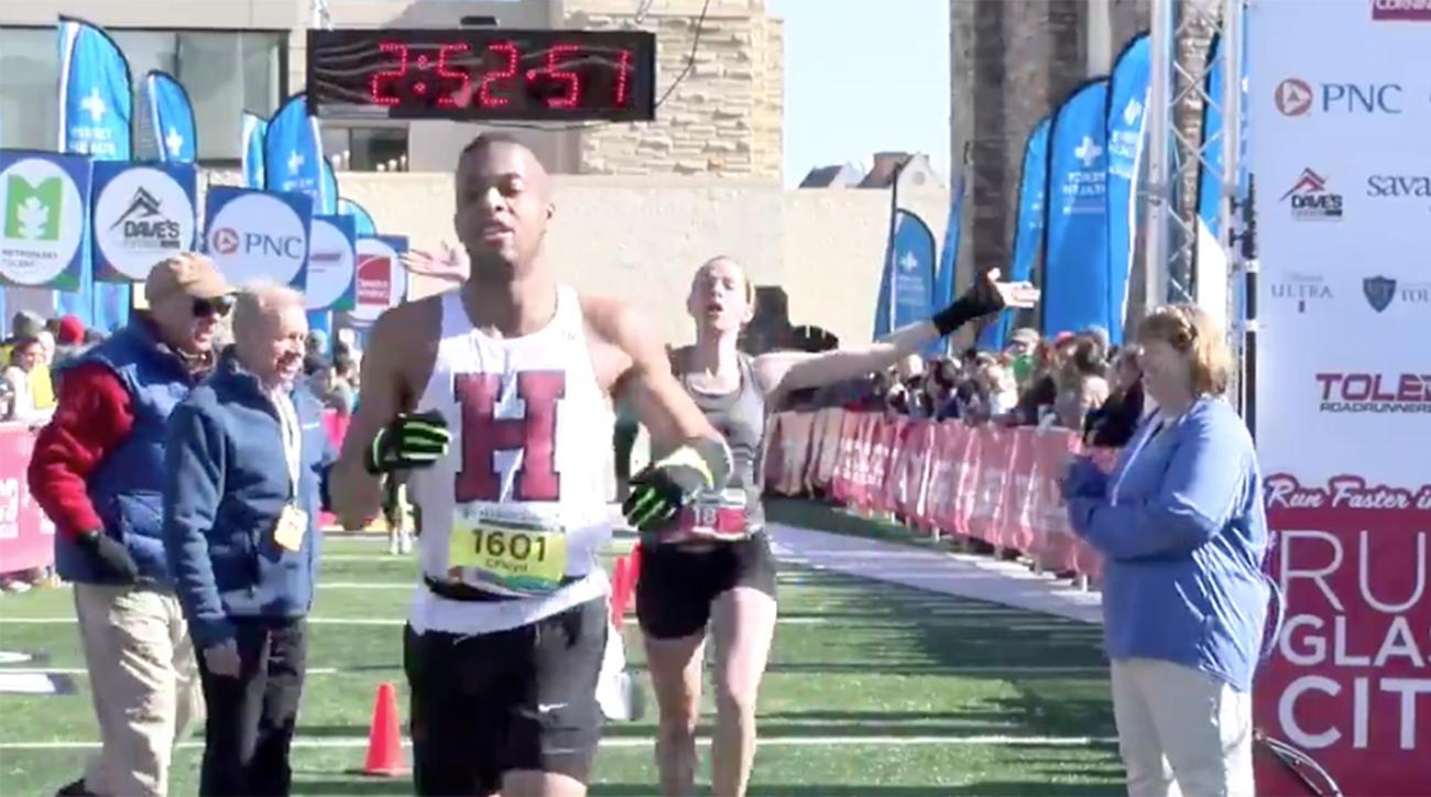 man-runs-through-womans-marathon-tape