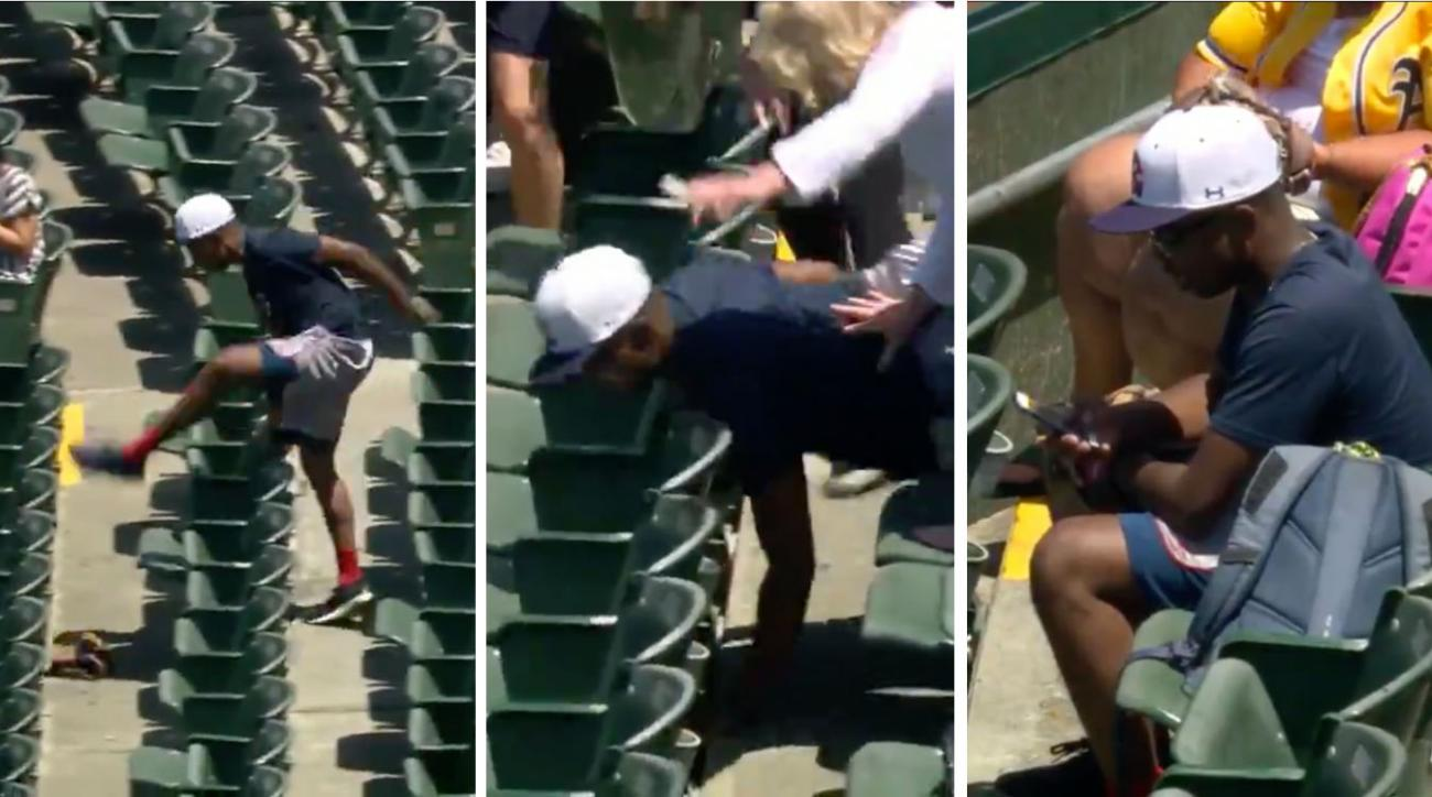 Fan chases baseball through stands