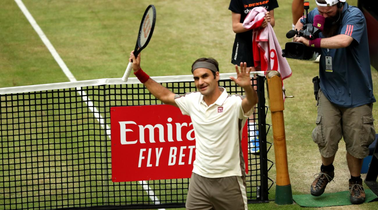 Roger Federer primed for Wimbledon charge after sealing 10th Halle Open crown