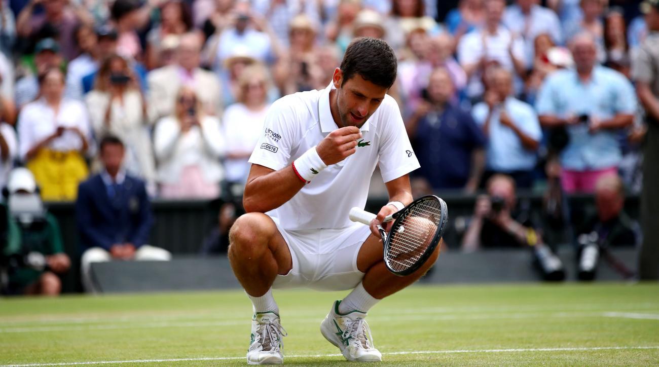 Novak Djokovic eats grass