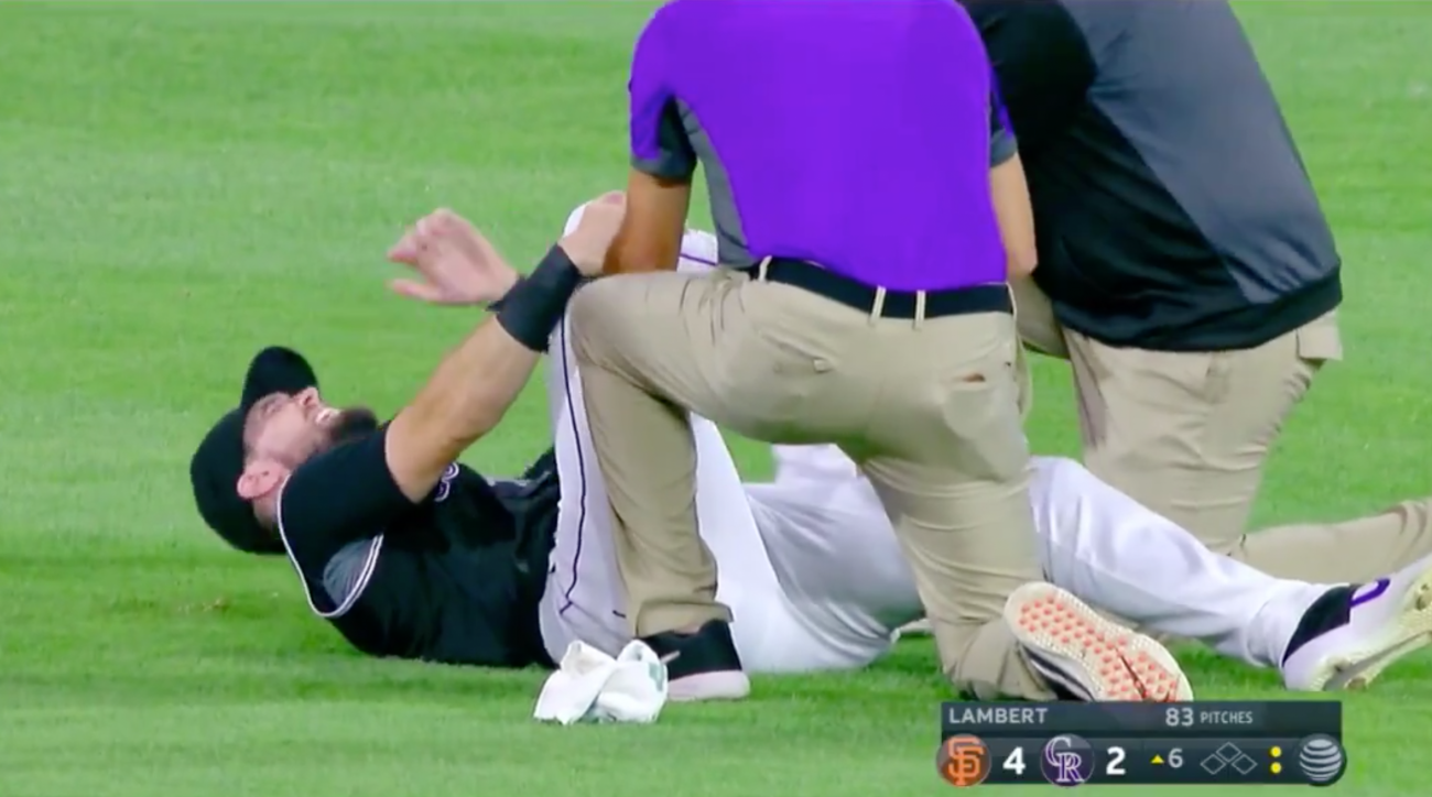Rockies All-Star Dahl carted off field after ugly ankle injury