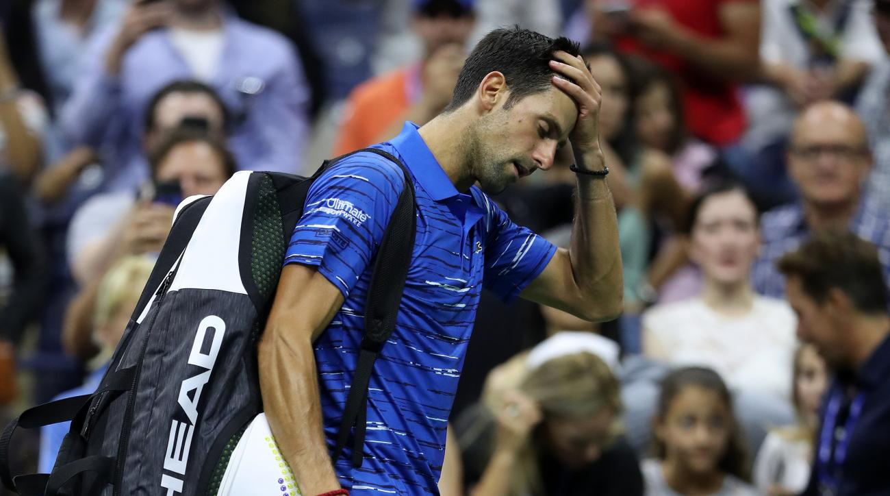 US Open champ Djokovic quits while down in 4th round