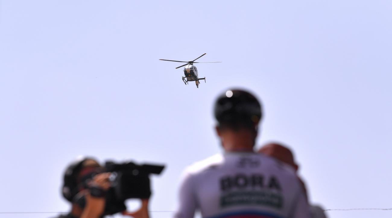 Helicopters covering Spanish cycling tour film rooftop cannabis patch