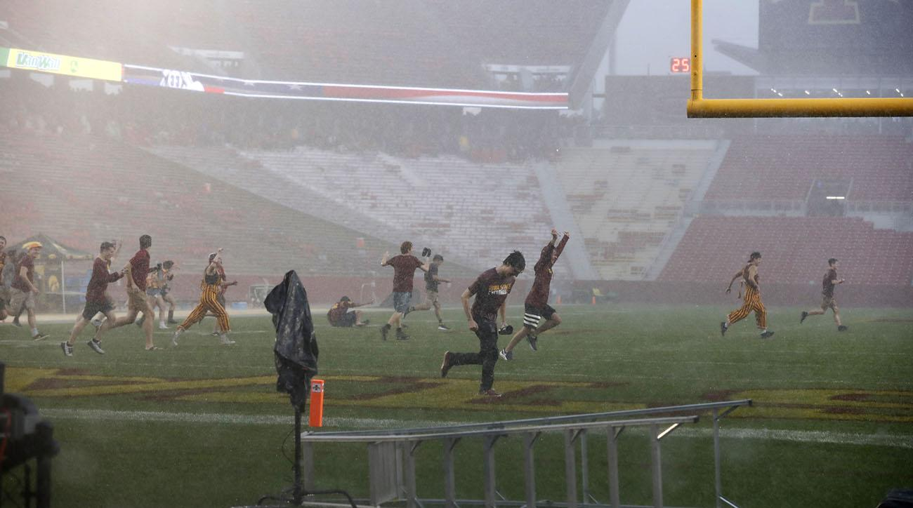 Iowa State Students Rush Field at Jack Trice Stadium During Weather Delay