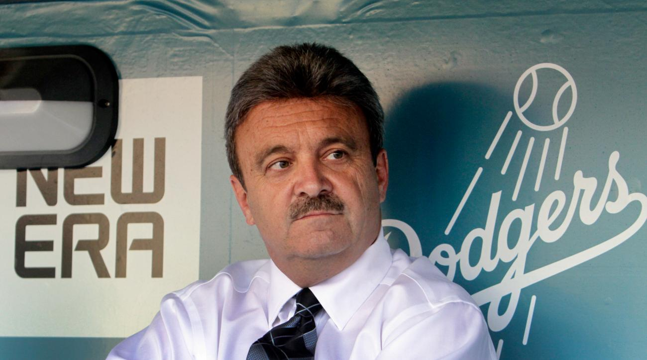 Dodgers' General Manager Ned Colletti in the dugout. LA Dodgers vs Atlanta Braves at Dodger Stadium