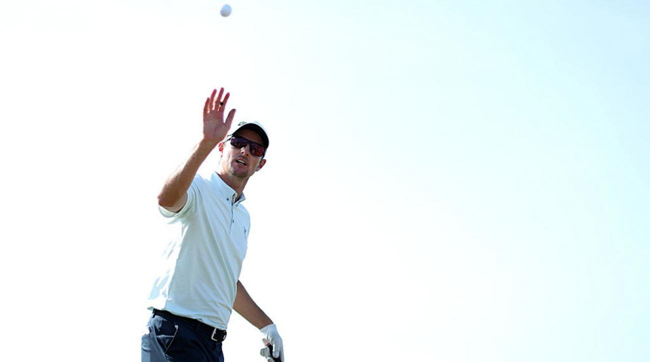Justin Rose catches a ball during a practice round ahead of the 2016 Players Championship.