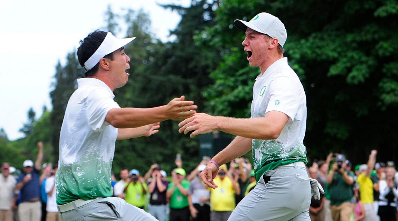Sulman Raza (right) sank the winning putt on the third hole of a playoff to give Oregon its first NCAA golf title.