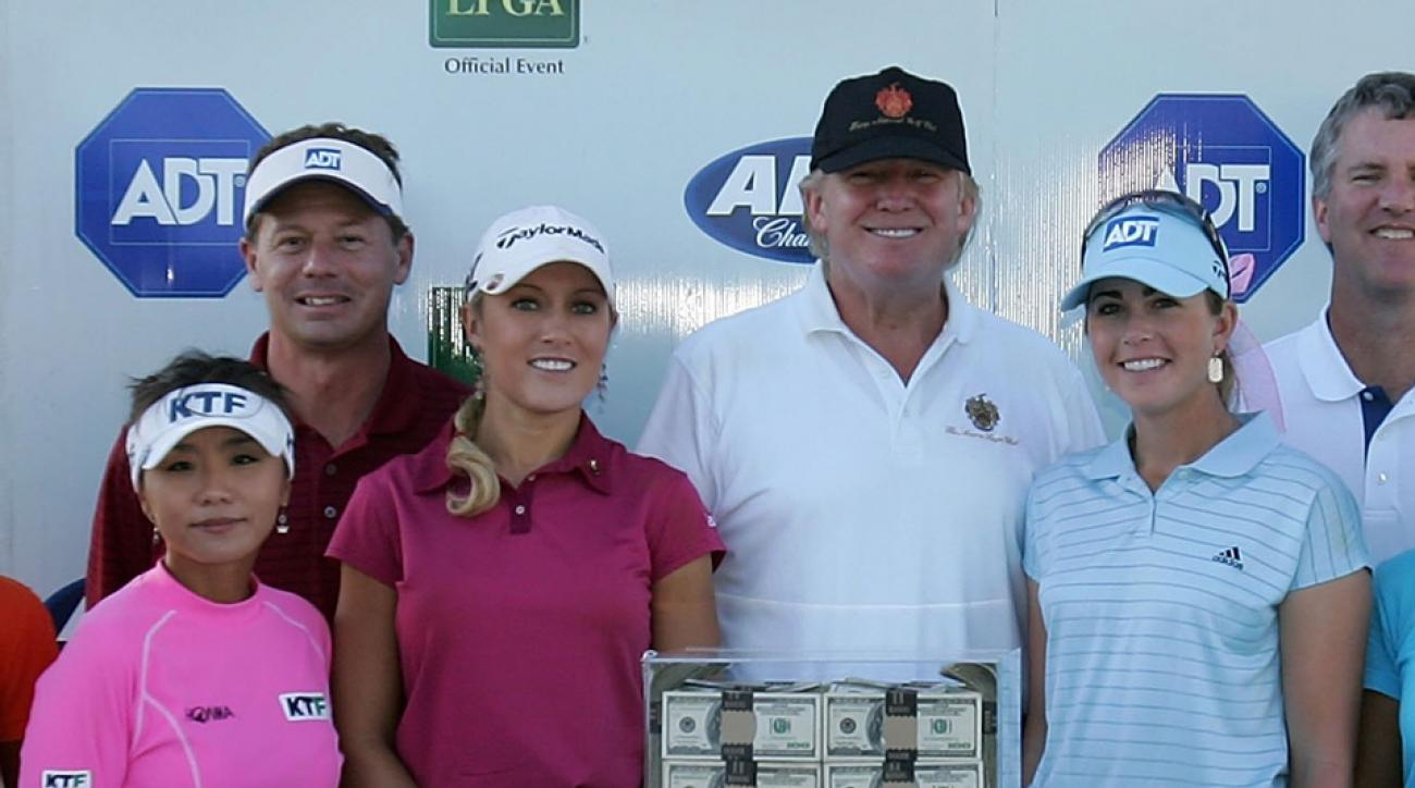 Natalie Gulbis and Donald Trump posed with competitors (including Paula Creamer, right) and sponsors at the 2006 ADT Championship at Trump International Golf Club in West Palm Beach, Fla.