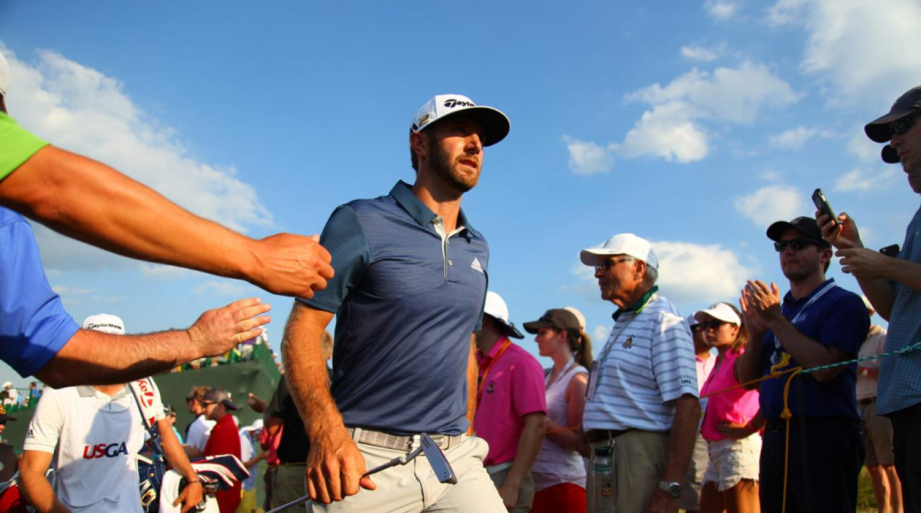 Dustin Johnson walks through the crowd during his victorious performance Sunday at the U.S. Open.