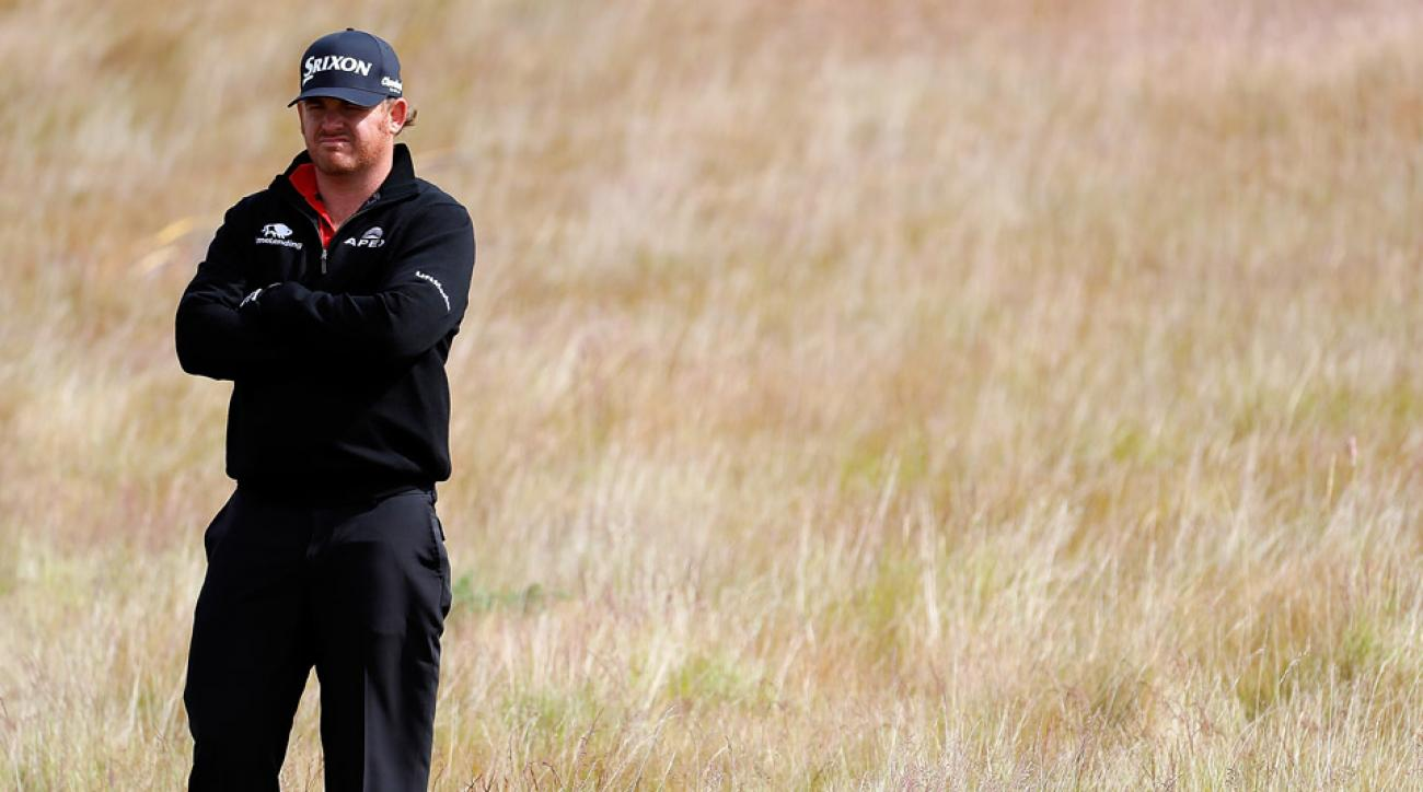 JB Holmes of the United States hits from the rough on the 14th hole during the first round of the AAM Scottish Open at Castle Stuart Golf Links on July 7, 2016 in Inverness, Scotland.