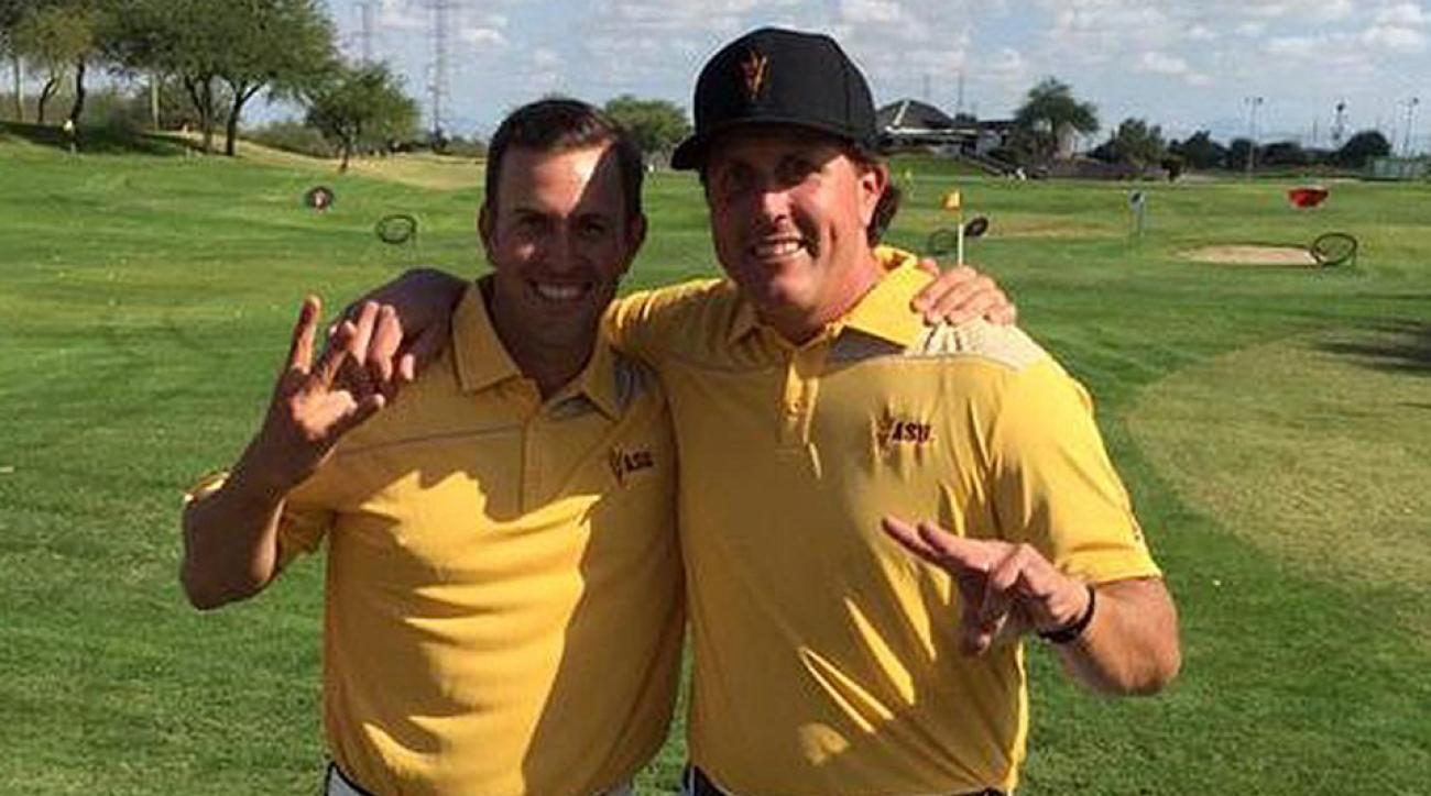 Tim Mickelson (left), standing with brother Phil Mickelson, has stepped down as the ASU men's golf coach.
