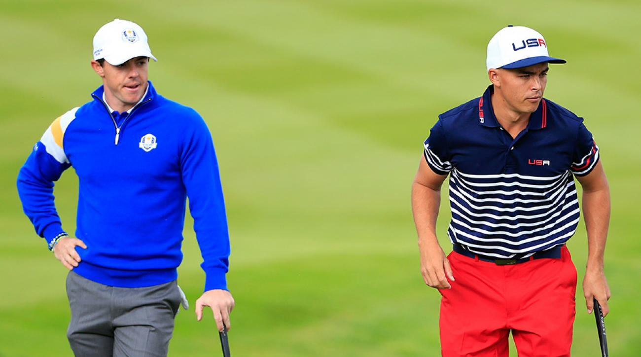 Rory McIlroy and Rickie Fowler on the 2nd green during the Singles Matches of the 2014 Ryder Cup.