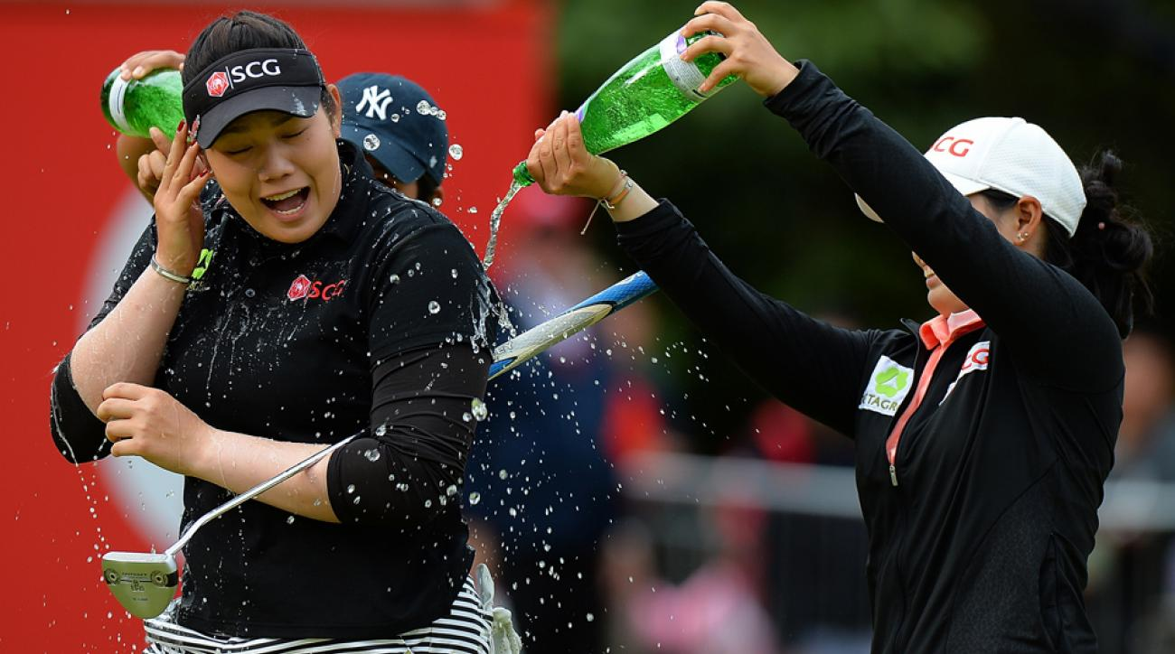 Ariya Jutanugarn celebrates her victory after holing the winning putt on the 18th green during the final round of the Women's British Open at Woburn Golf Club on July 31, 2016, in Woburn, England.