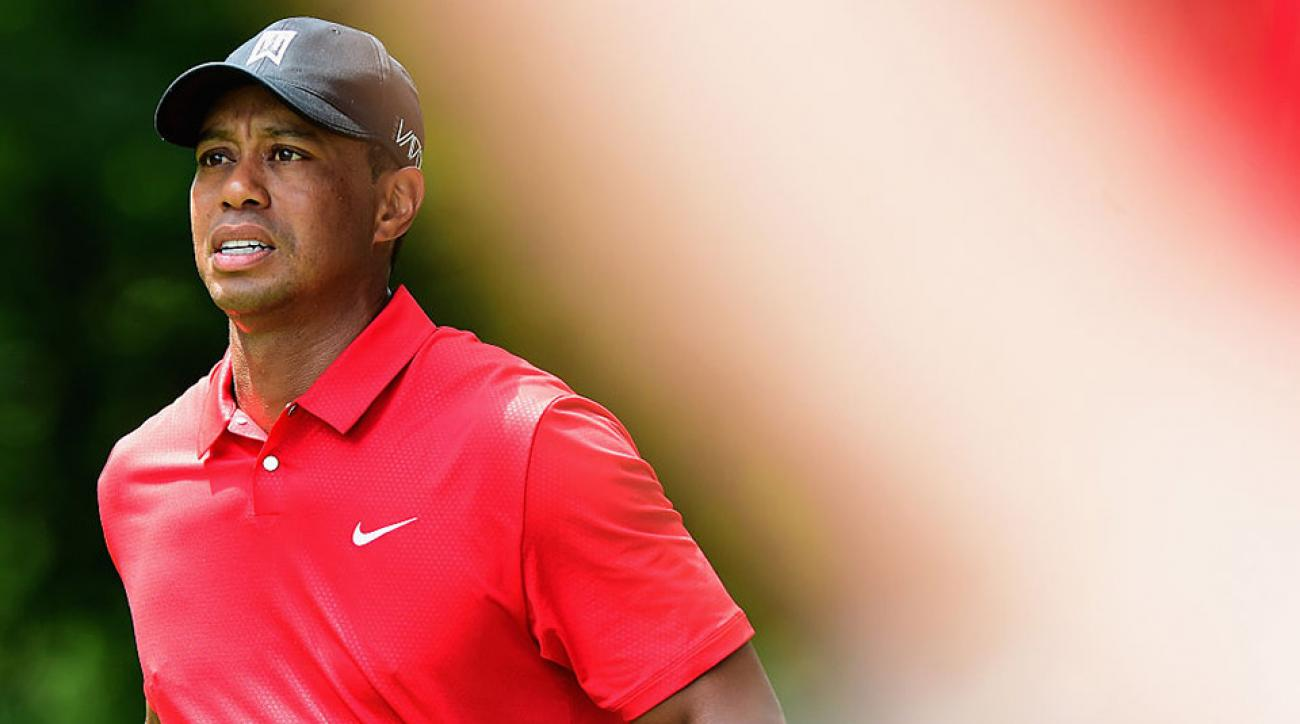 Tiger Woods walks off the second tee box during the final round of the 2015 Wyndham Championship.