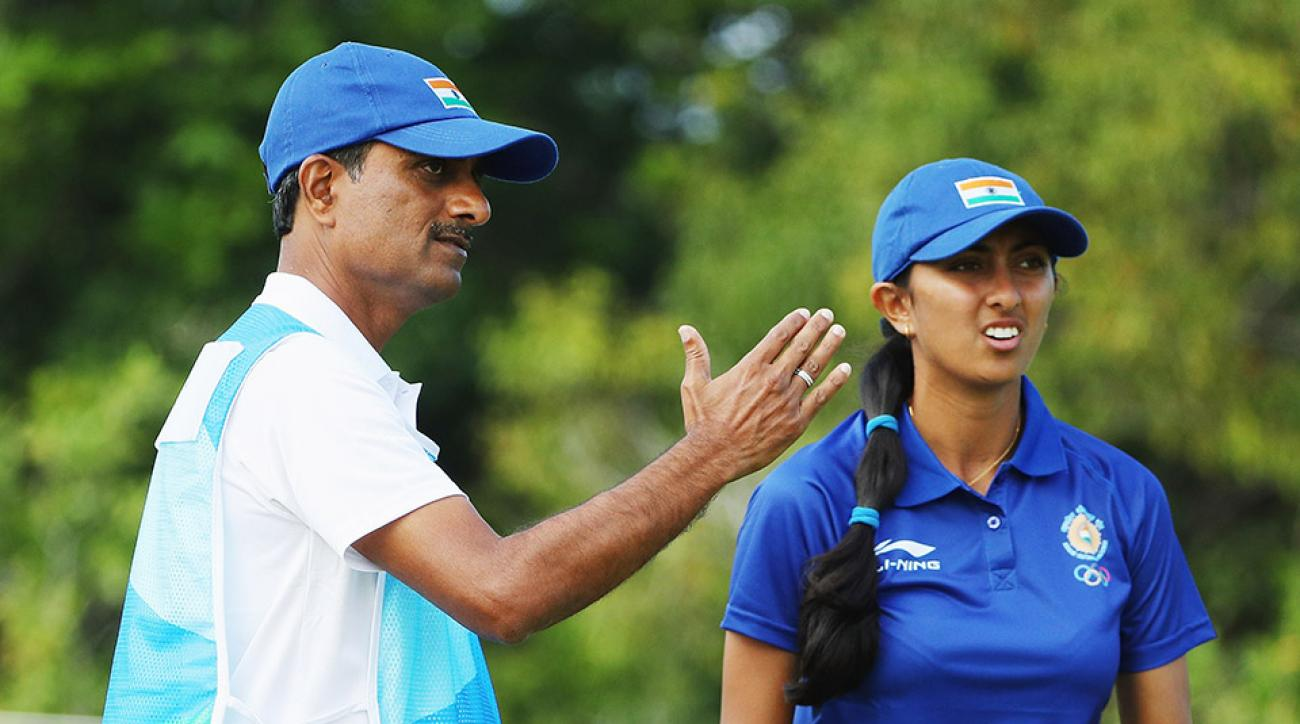 Aditi Ashok of India chats with her father/caddie Pandit Gudlamani during the second round of women's Olympic golf.