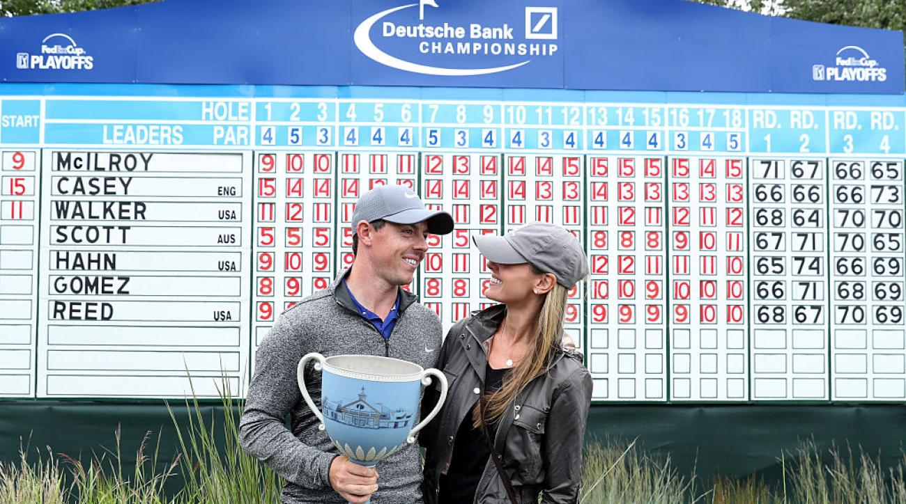 Rory McIlroy and fiancee Erica Stoll pose with the trophy after the final round of the Deutsche Bank Championship.