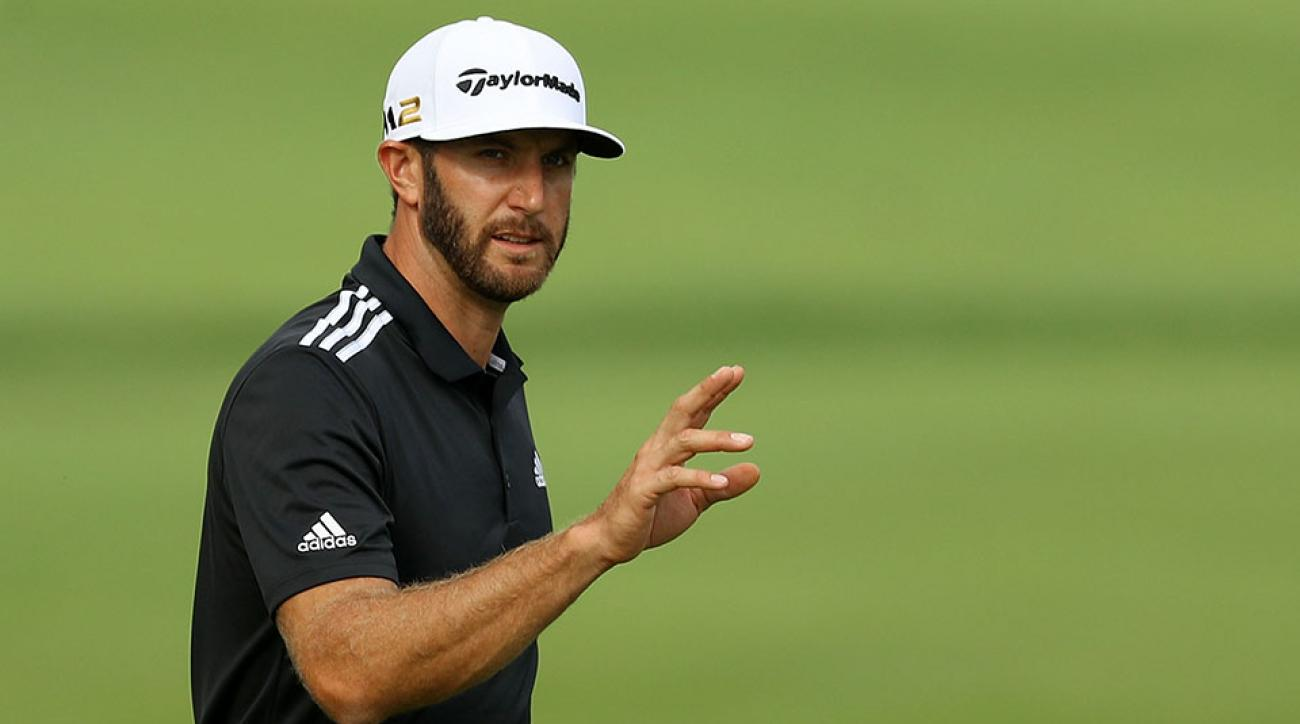 Dustin Johnson waves to the crowd following a birdie on the ninth green during the third round of the BMW Championship at Crooked Stick Golf Club