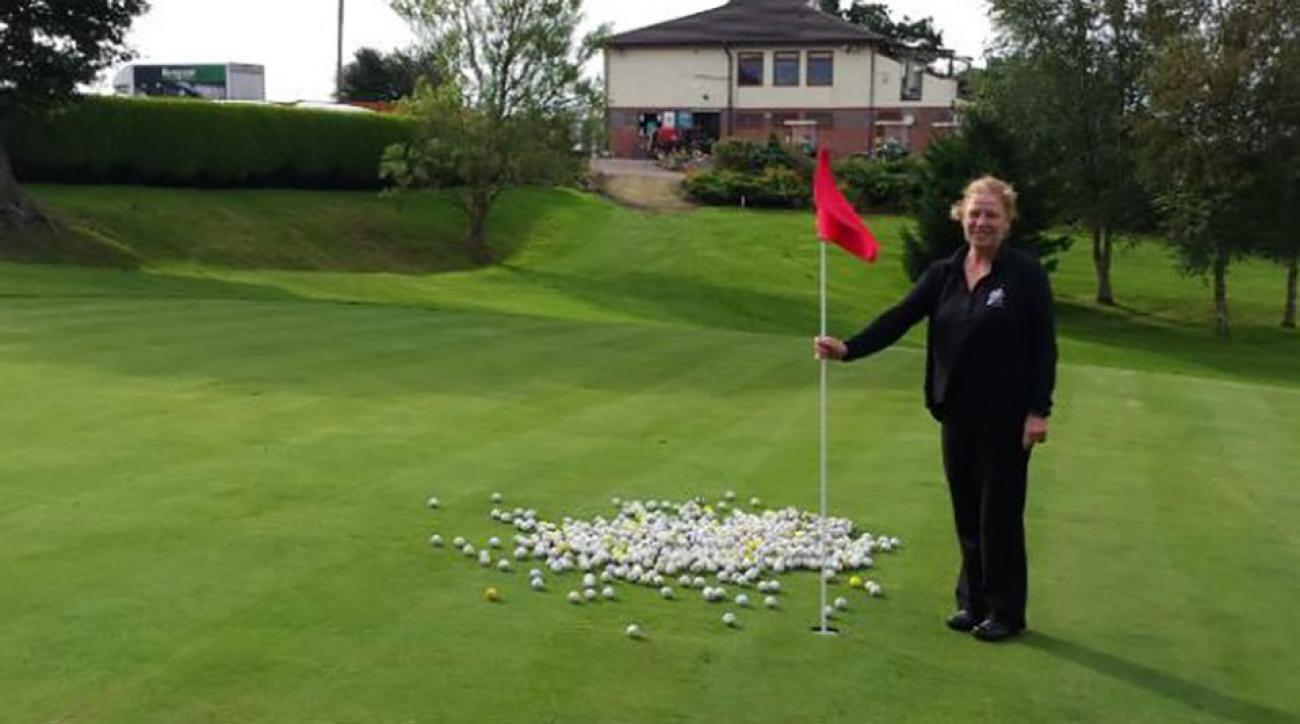 Sarah Bathew, co-owner of the Manor Golf Club, poses with the loot the thieves took from the club's lake.