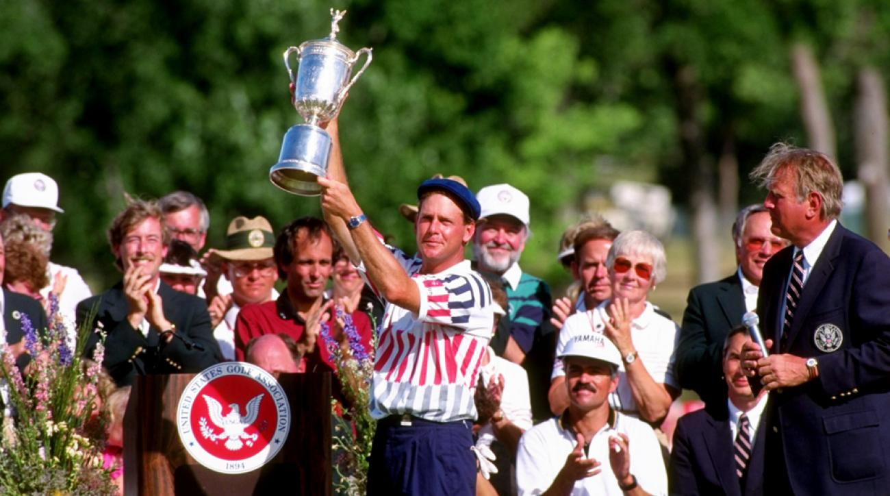 Payne Stewart holds up his trophy after winning the 1991 U.S. Open at Hazeltine National Golf Club in Chaska, Minnesota. Stewart won his first Open in a Monday playoff.