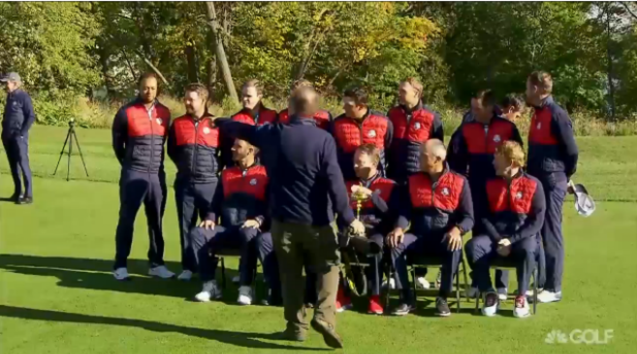 Tiger Woods thought he was a part of the team photo, until he was told to move out of the shot twice.