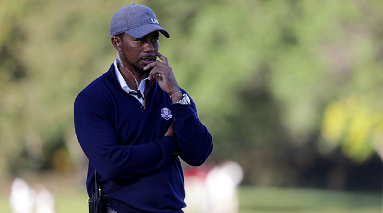 Vice-captain Tiger Woods of the United States looks on from the 14th hole during afternoon fourball matches of the 2016 Ryder Cup at Hazeltine National Golf Club.