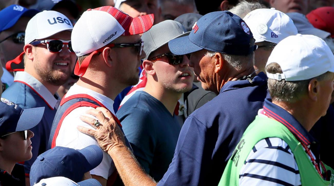 Team USA's vice captain Tom Lehman speaks to a fan who was heckling Sergio Garcia on Saturday.