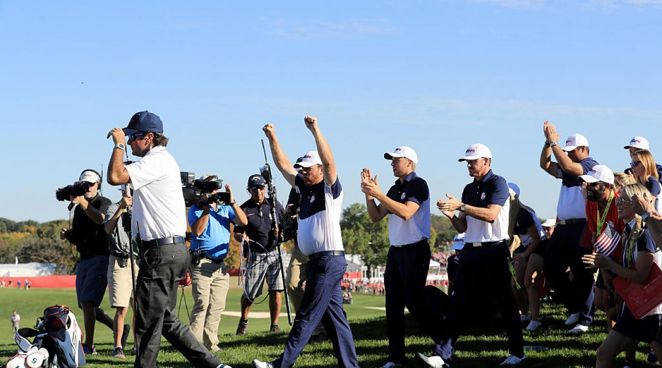 Vice-captain Bubba Watson, J.B. Holmes, Jordan Spieth and Jimmy Walker celebrate on the 18th green after winning the Ryder Cup.