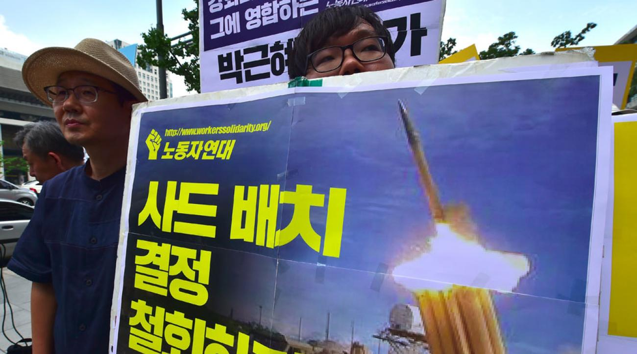 South Korean activists protest the military's plans to deploy missile defense units to their town.