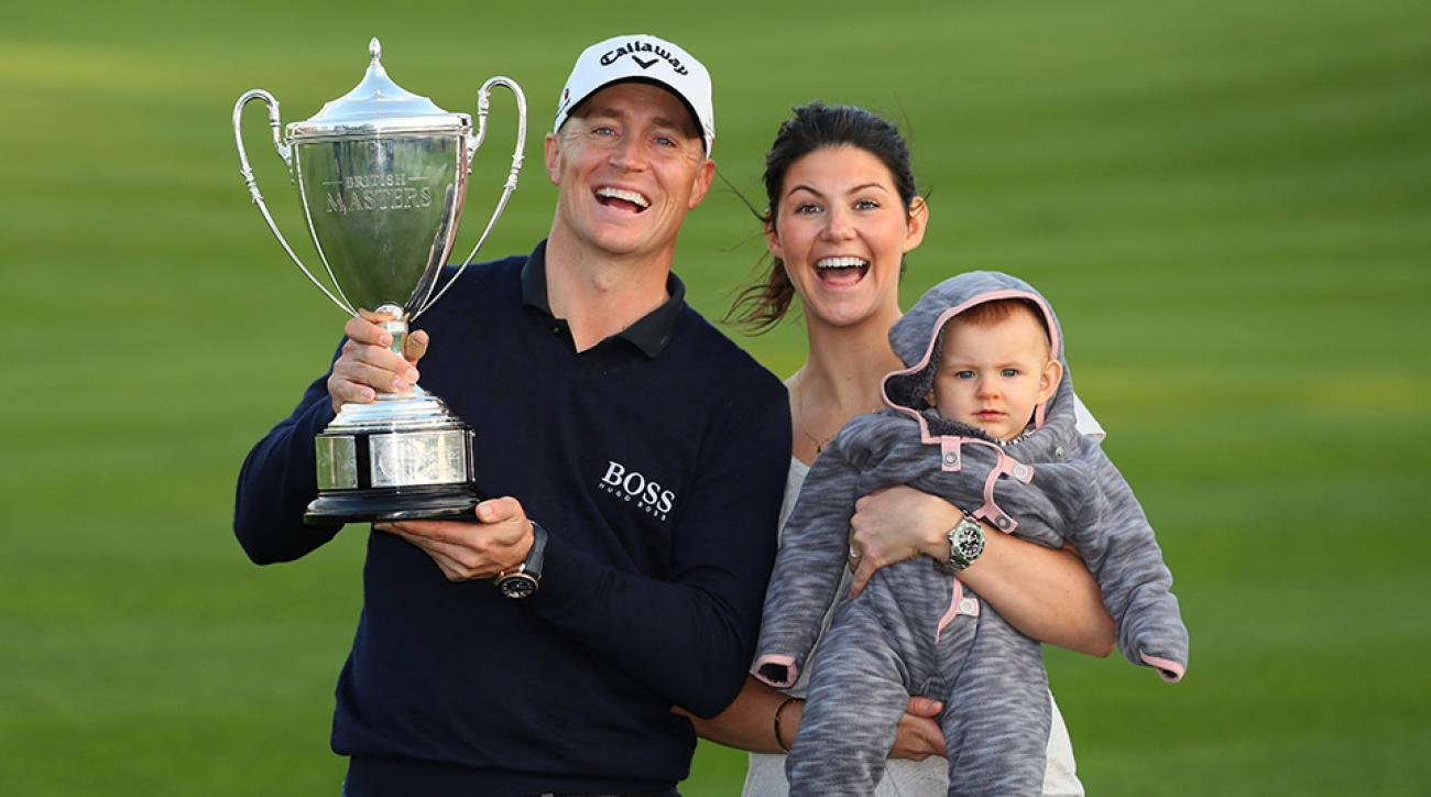 Alex Noren celebrates his British Masters vicotry with his family.