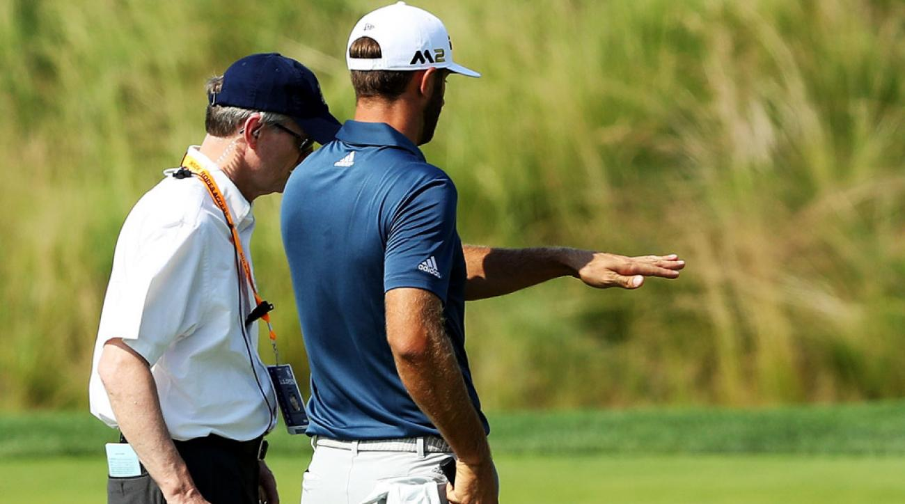 Dustin Johnson speaks to a rules official during the final round of the 2016 U.S. Open.